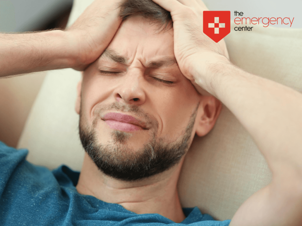 Man holding head in pain with migraine